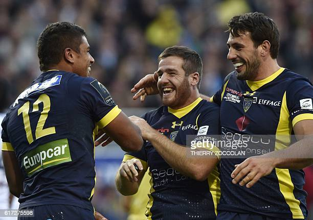 Clermont's French centre Wesley Fofana celebrates with Clermont's French flyhalf Camille Lopez and Clermont's French centre Remi Lamerat after...