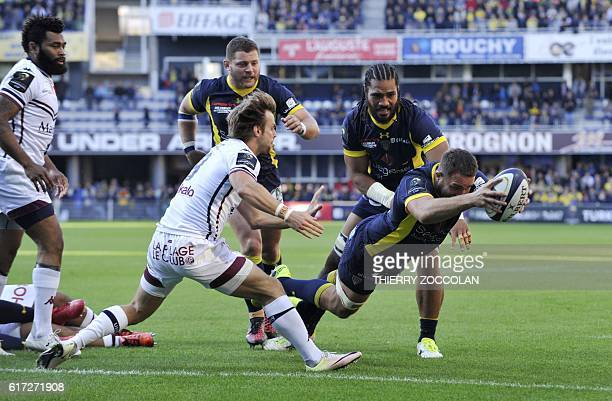 Clermont's French flanker Alexandre Lapandry scores a try during the European Rugby Champions Cup rugby match between Clermont and Bordeaux Begles at...