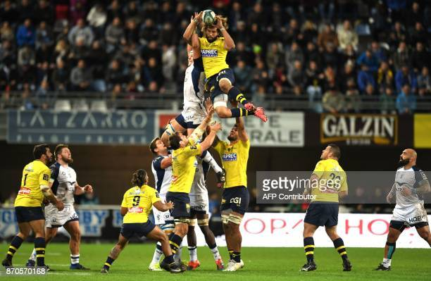 TOPSHOT Clermont's French flanker Camille Gerondeau grabs the ball in a line out during the French Top 14 Rugby union match between Montpellier and...