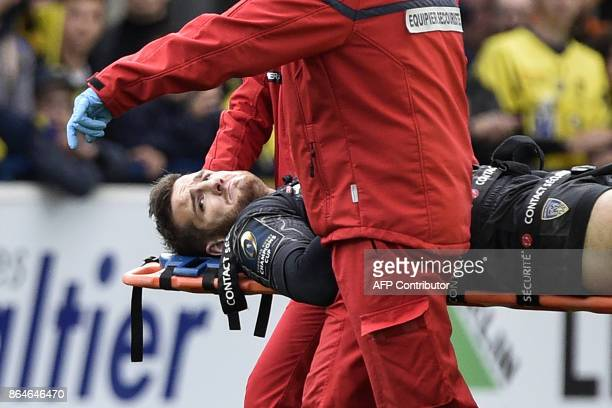Clermont's French flyhalf Camille Lopez is being evacuated on a stretcher after suffering an injury during the European Rugby Champions Cup match ASM...