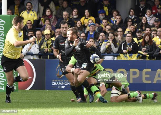 Clermont's French flyhalf Camille Lopez is being tackled during the European Rugby Champions Cup match ASM Clermont Auvergne vs Northampton Saints at...