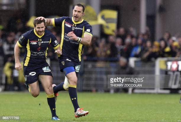 Clermont's French flyhalf Camille Lopez is congratulated by Clermont's English fullback Scott Spedding after a drop during the European Champions Cup...