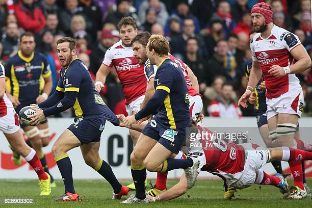 Clermont's French flyhalf Camille Lopez is grabbed by the shirt by Ulster's Irish lock Iain Henderson during the European Rugby Champions Cup rugby...