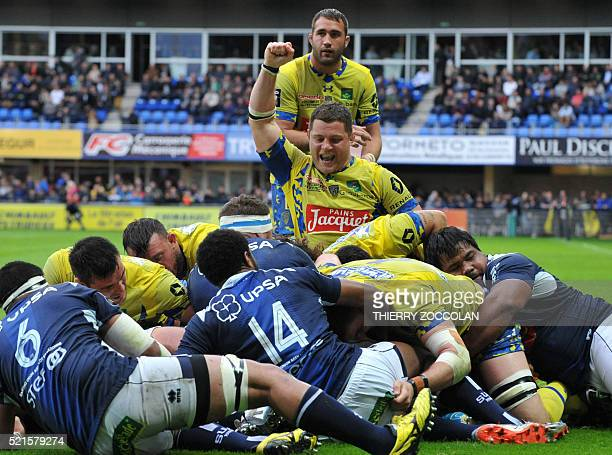 Clermont's French hooker Benjamin Kayser celebrates after Clermont's French flanker Judicaël Cancoriet scored a try during the French Top 14 Rugby...