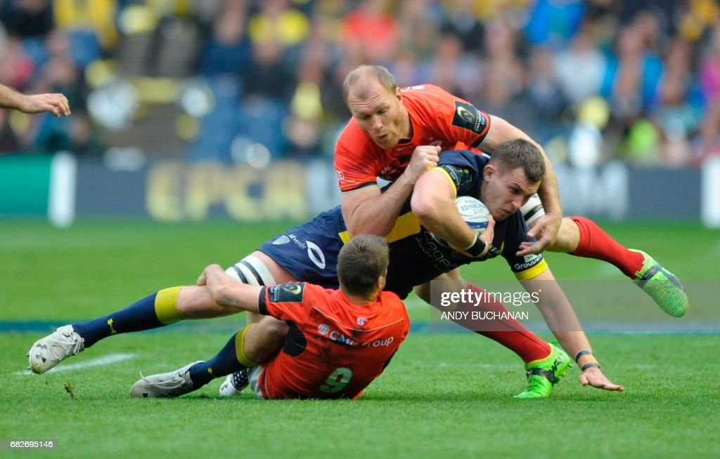 Clermont's French lock Paul Jedrasiak is tackled by Saracens' English scrum-half Richard Wigglesworth and Saracens' South African flanker Schalk Burger (up) during the rugby union European Champions Cup Final match between Saracens and Clermont Auvergne at Murrayfield Stadium in Edinburgh, Scotland on May 13, 2017. Saracens won the game 28-17. /
