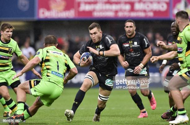 Clermont's French lock Paul Jedrasiak runs with the ball during the European Rugby Champions Cup match ASM Clermont Auvergne vs Northampton Saints at...