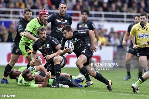 Clermont's French scrumhalf Charlie Cassang runs on his way to score a try during the European Rugby Champions Cup match ASM Clermont Auvergne vs...