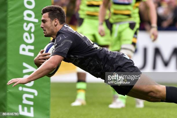 Clermont's French scrumhalf Charlie Cassang scores a try during the European Rugby Champions Cup match ASM Clermont Auvergne vs Northampton Saints at...