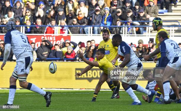 Clermont's French scrumhalf Charly Trussardi passes the ball during the French Top 14 Rugby union match between ASM Clermont and SU Agen at the...