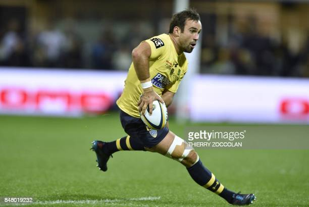 Clermont's French scrumhalf Morgan Parra passes the ball during the French Top 14 rugby union match between ASM Clermont and CA Brive at Michelin...