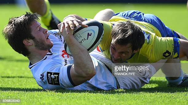Clermont's French scrum-half Morgan Parra tackles Racing 92 French right wing Louis Dupichot during the French Top 14 rugby union match between...