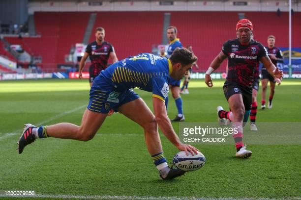 Clermont's French wing Damian Penaud scores his team's third try during the European Rugby Champions Cup rugby union Group B match between Bristol...