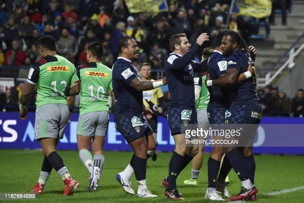 Clermont's French winger Alivereti Raka celebrate with teammates after scoring a try during the European Champions Cup rugby union match between...