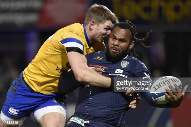 Clermont's French winger Alivereti Raka is tackled by Bath's winger Ruaridh McConnochie during the European Champions Cup rugby union match between...