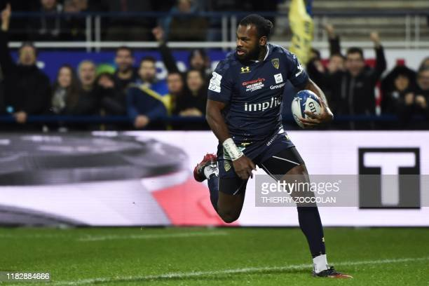 Clermont's French winger Alivereti Raka scores a try during the European Champions Cup rugby union match between Clermont and Harlequins at the...