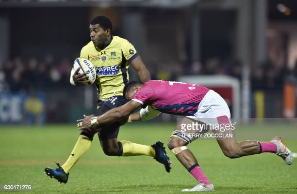Clermont's French winger Noa Nakaitaci rides the ball during the Top 14 French Union Rugby match ASM Clermont vs Stade Français at the Michelin...