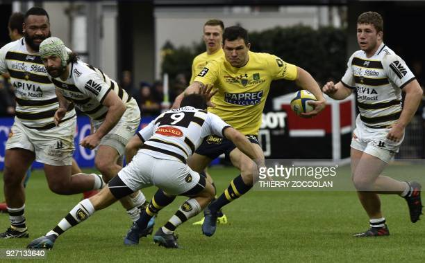 Clermont's French winger Remy Grosso vies with La Rochelle's players during the French Top 14 rugby match ASM Clermont versus La Rochelle at the...