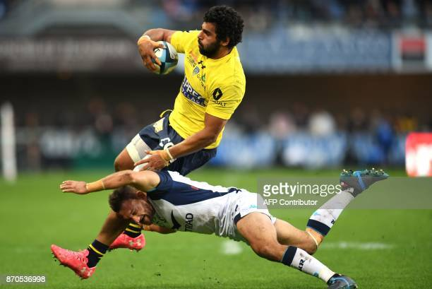 Clermont's Georgian flanker Viktor Kolelishvili vies with Montpellier's New Zealand fly half Aaron Cruden during the French Top 14 rugby union match...