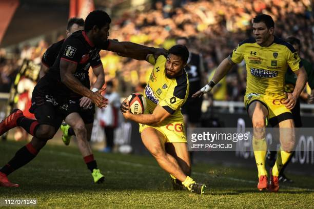 Clermont's New Zealander centre George Moala is tackled by Lyon's Fijian wing Noa Nakaitaci during the French Top 14 rugby union match Lyon vs...