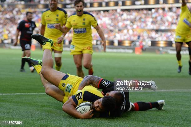 Clermont's New Zelander centre George Moala scores a try during the French Top 14 semifinal rugby union match between Clermont and Lyon on June 9...