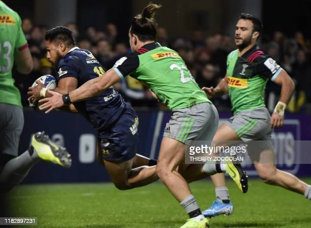 Clermont's New Zelander centre George Moala scores a try during the European Champions Cup rugby union match between Clermont and Harlequins at the...