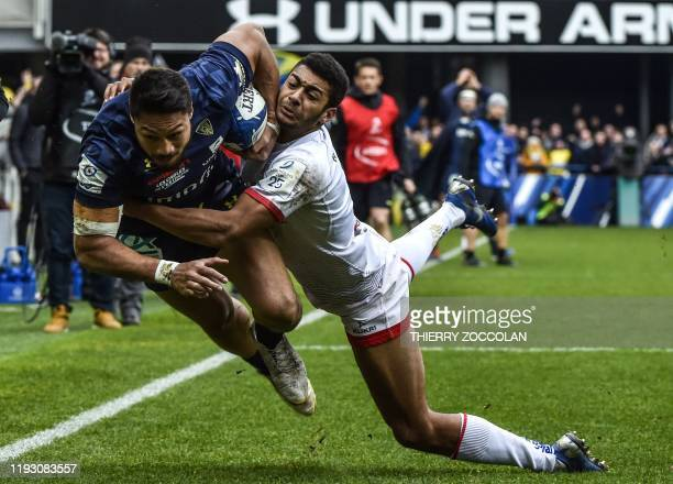 Clermont's NewZealander fullback Isaia Toeava is tackled during the European Champions Cup rugby union match between Clermont and Ulster at the...
