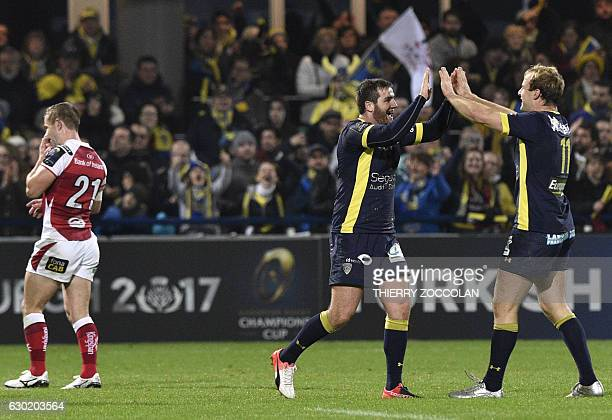 Clermont's players celebrate at the end of the European Champions Cup rugby union match between Clermont and Ulster at the Michelin stadium in...