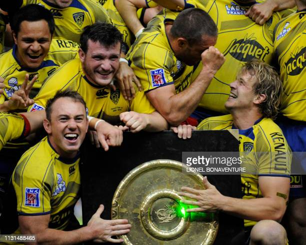 Clermont's players celebrate with the ' bouclier de Brennus ' shield after winning the French Top 14 rugby union final match Perpignan versus...