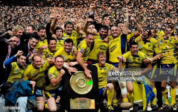 Clermont's players celebrate with the Brennus shield after winning the French Top 14 rugby union final match Perpignan versus ClermontFerrand on May...