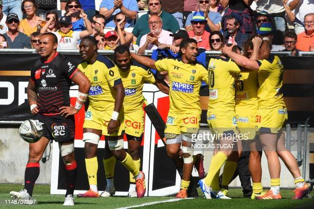 Clermont's players react after scoring a try during the French Top 14 semifinal rugby union match between Clermont and Lyon on June 9 2019 at the...