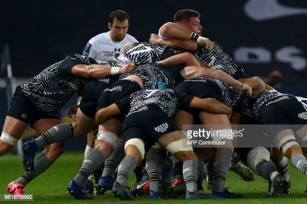 Clermont's prop Rabah Slimani is seen in the middle of the scrum during the European Rugby Champions Cup rugby union round 1 pool match between...