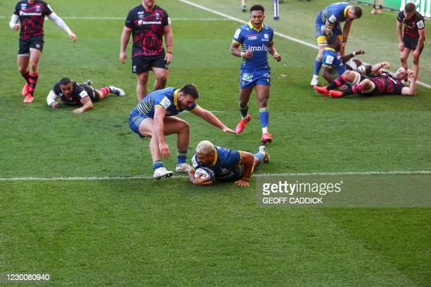 Clermont's Samoa number 8 Fritz Lee is congratulated by Clermont's French hooker Etienne Fourcade after scoring a try during the European Rugby...