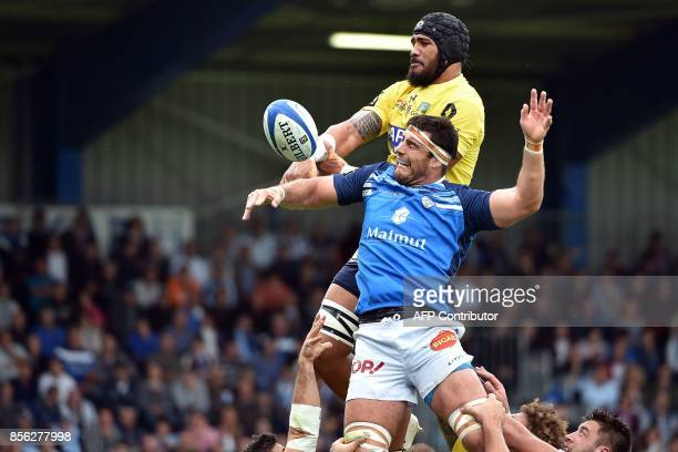 Clermont's Tongan lock Sitaleki Timani grabs the ball in a line out during the French Top 14 rugby union match between Castres and Clermont at the...