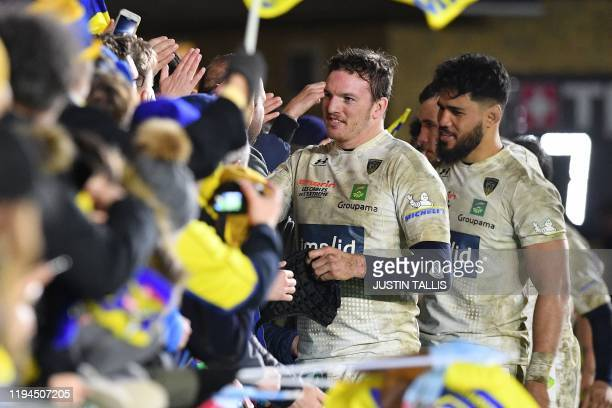 Clermont's Tonganborn Australian lock Sitaleki Timani and Clermont's French number 8 Arthur Iturria applaud the fans after the European Rugby...