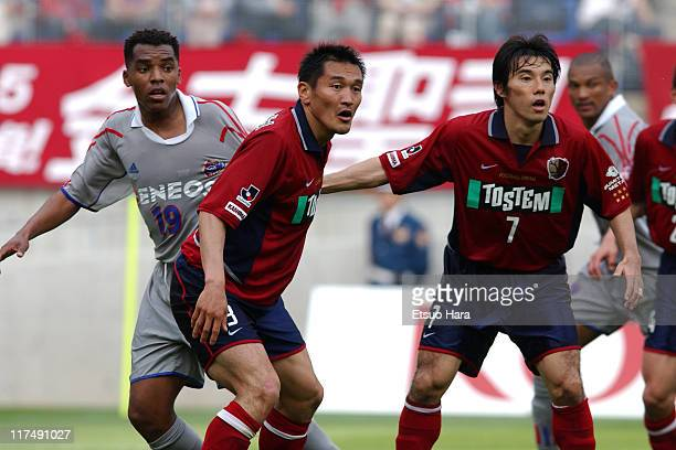 Clesly Evandro Guimaraes or Kelly of FC Tokyo competes for the ball with Yutaka Akita and Naoki Soma of Kashima Antlers during the JLeague Division 1...