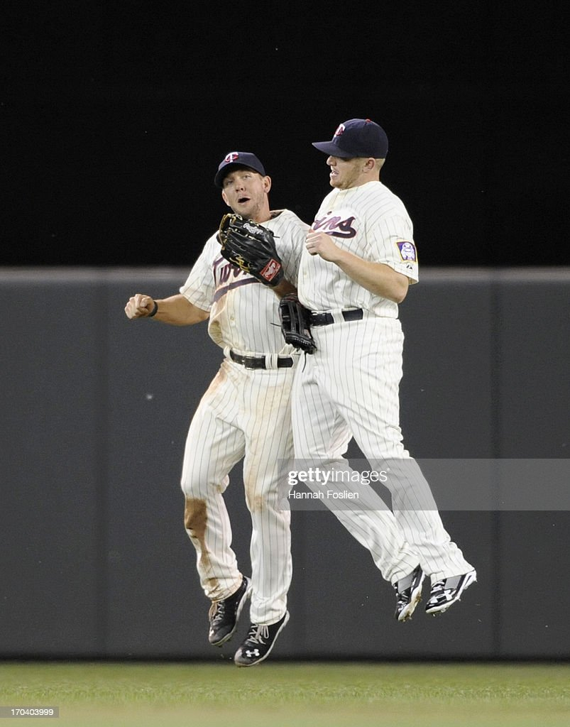 Clete Thomas #11 and Chris Parmelee #27 of the Minnesota Twins celebrate a win of the game against the Philadelphia Phillies on June 12, 2013 at Target Field in Minneapolis, Minnesota. The Twins defeated the Phillies 4-3.