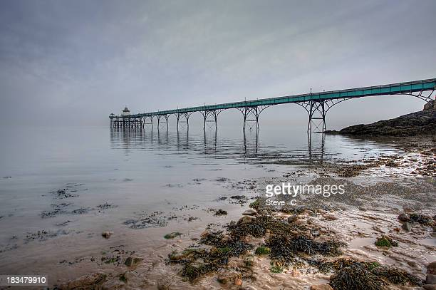 clevedon pier disappearing into the mist - clevedon pier stock pictures, royalty-free photos & images