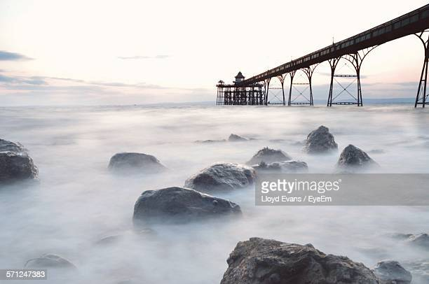 clevedon pier over sea during foggy weather - clevedon pier stock pictures, royalty-free photos & images
