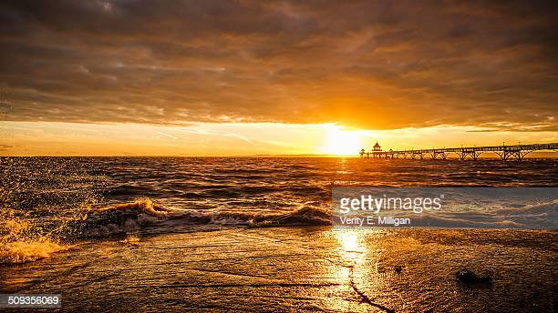 clevedon pier sunset over a stormy sea - clevedon pier stock pictures, royalty-free photos & images