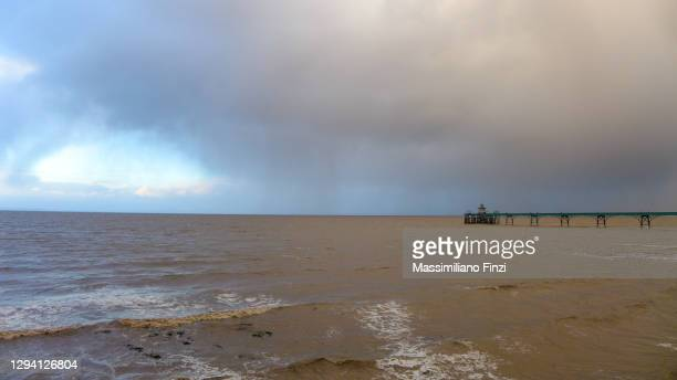 clevedon pier with raining storm over the sea in winter - clevedon pier ストックフォトと画像