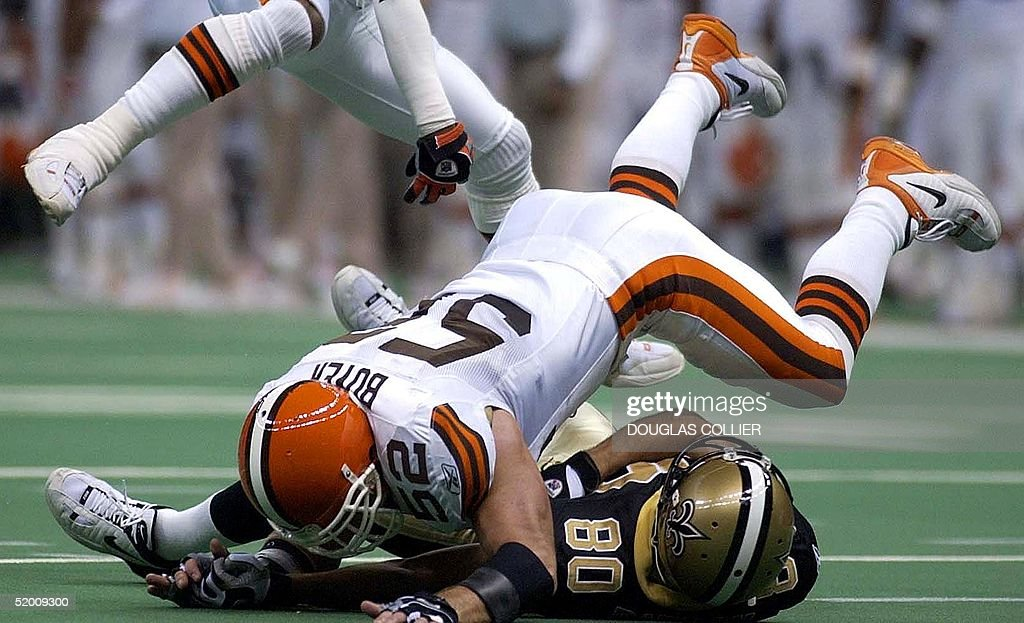 Cleveland Browns' Brant Boyer (TOP) flattens New Orleans Saints' Jerome Pathon on a failed pass attempt in the first quarter 24 November 2002 at the Louisiana Superdome in New Orleans, Louisiana.