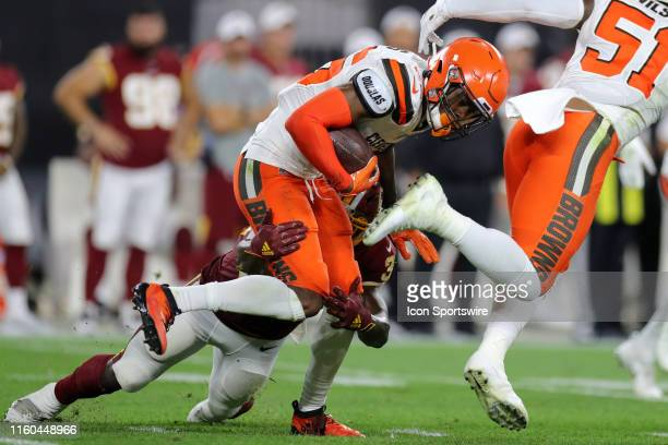 Cleveland Browns cornerback Greedy Williams is tackled by Washington Redskins running back Byron Marshall after making an interception during the...