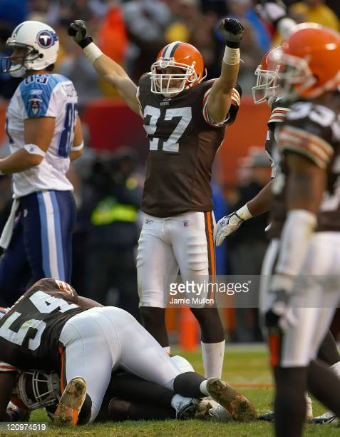 Cleveland Browns Defensive Back Brian Russell raises his arms in victory after team mate Brodney Pool intercepts the last play of the game against...
