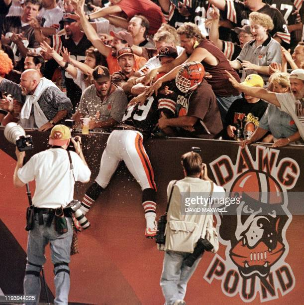 Cleveland Browns defensive back Marlon Forbes leaps into the arms of fans in the Dawg Pound section of the stadium as the team takes the field for...