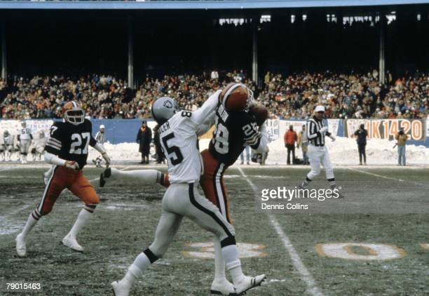 Cleveland Browns defensive back Ron Bolton intercepts a pass during the Browns 1412 loss to the Oakland Raiders in the 1980 AFC Divisional Playoff...