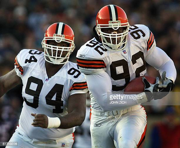 Cleveland Browns defensive end Courtney Brown runs for a touchdown with blocking from teammate Gerard Warren after recovering a fumble by the Chicago...