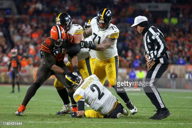 Cleveland Browns defensive end Myles Garrett attempts to remove the helmet of Pittsburgh Steelers quarterback Mason Rudolph as Pittsburgh Steelers...