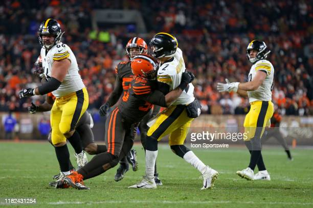 Cleveland Browns defensive end Myles Garrett hits Pittsburgh Steelers quarterback Mason Rudolph after Rudolph threw a pass during the fourth quarter...