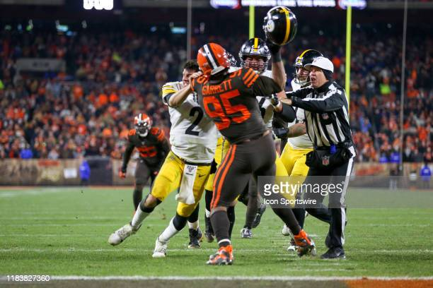 Cleveland Browns defensive end Myles Garrett prepares to strike Pittsburgh Steelers quarterback Mason Rudolph in the head with his own helmet as...