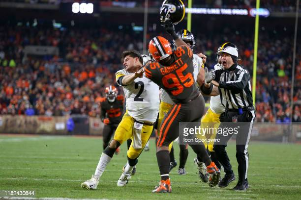 Cleveland Browns defensive end Myles Garrett swings at Pittsburgh Steelers quarterback Mason Rudolph with Rudolphs own helmet with 0:08 seconds left...